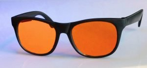 Image of a single pair of orange viewing glasse
